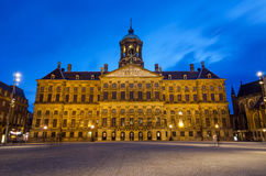 Amsterdam, Netherlands - May 7, 2015: People visit Royal Palace at Dam Square in Amsterdam. Stock Photos
