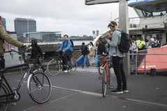 Eople waiting for the ferry. Amsterdam, Netherlands - May 16, 2018: People waiting for the ferry in Amsterdam Noord stock photos
