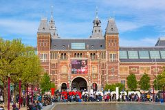 Amsterdam, Netherlands - May, 2018: Rijksmuseum Amsterdam museum with words I Amsterdam and tourists. Famous landmark in Netherlan Royalty Free Stock Photos