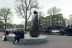 Amsterdam. NETHERLANDS - MAY, 15, 2017: Statue of Baruch Spinoza near the place where he lived  Zwanenburgwal Royalty Free Stock Photography