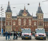 Police busses guarding the Central station in Amsterdam Royalty Free Stock Images