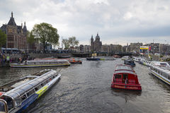 Amsterdam. NETHERLANDS - MAY, 12, 2017: Tourists embarking on the boats that run through the canals Stock Photo