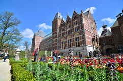 Amsterdam, Netherlands - May 6, 2015: Tourists at the garden around the Rijksmuseum Stock Images