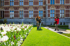 Amsterdam, Netherlands - May 6, 2015: Tourists at the garden around the Rijksmuseum. Royalty Free Stock Photos