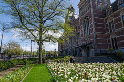 Amsterdam, Netherlands - May 6, 2015: Tourists at the garden around the Rijksmuseum Royalty Free Stock Photos