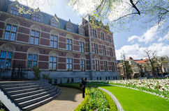 Amsterdam, Netherlands - May 6, 2015: Tourists at the garden around the Rijksmuseum Royalty Free Stock Image