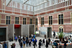 Amsterdam, Netherlands - May 6, 2015: Tourists in the modern atrium Rijksmuseum Royalty Free Stock Image