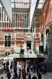 Amsterdam, Netherlands - May 6, 2015: Tourists in the modern atrium Rijksmuseum Stock Photography
