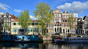 Amsterdam, Netherlands - May 7, 2015: Traditional houses of Amsterdam with canal in Amsterdam stock video footage