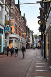 Amsterdam, Netherlands - May 7, 2015: Unidentified people Shopping on Kalverstraat Royalty Free Stock Photography