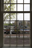 Amsterdam. NETHERLANDS - MAY, 13, 2017: View of the city of  through a window Stock Images