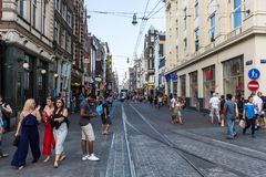 View of people shopping and tourists at the Leidsestraat Street. AMSTERDAM, NETHERLANDS - MAY 27, 2017: View of people shopping and tourists at the Leidsestraat Stock Photography