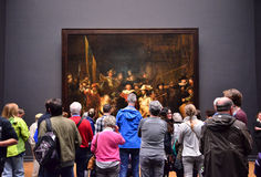 Amsterdam, Netherlands - May 6, 2015: Visitors at the famous painting Night watch at Rijksmuseum Royalty Free Stock Images