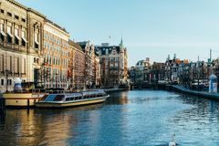 Beautiful Architecture Of Dutch Houses and Houseboats On Amsterdam Canal In Autumn. AMSTERDAM, NETHERLANDS - NOVEMBER 13, 2017: Beautiful Architecture Of Dutch Stock Photos