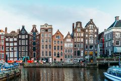 Beautiful Architecture Of Dutch Houses and Houseboats On Amsterdam Canal In Autumn Stock Photography
