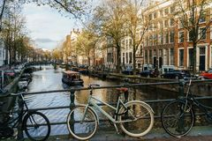Bicycles and Dutch Houses On Amsterdam Canal In Autumn. AMSTERDAM, NETHERLANDS - NOVEMBER 13, 2017: Bicycles and Dutch Houses On Amsterdam Canal In Autumn Royalty Free Stock Photos