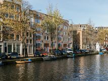 Common Dutch Houses and Houseboats On Amsterdam Canal In Autumn Royalty Free Stock Image