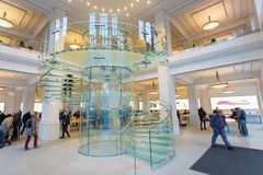AMSTERDAM, NETHERLANDS. Glass Stairs inside of Apple Store in Amsterdam. AMSTERDAM, NETHERLANDS - November 6, 2017: Glass Stairs inside of Apple Store in Royalty Free Stock Images