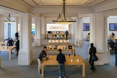 IPhone Mobile Phones and iPad Tablets For Sale in Apple Store. AMSTERDAM, NETHERLANDS - NOVEMBER 13, 2017: iPhone Mobile Phones and iPad Tablets For Sale in Stock Photos