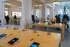 IPhone Mobile Phones and iPad Tablets For Sale in Apple Store. AMSTERDAM, NETHERLANDS - NOVEMBER 13, 2017: iPhone Mobile Phones and iPad Tablets For Sale in Stock Image
