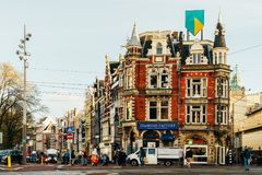 People Walking In Downtown Amsterdam Admiring Beautiful Architecture Of Dutch Houses In Autumn. AMSTERDAM, NETHERLANDS - NOVEMBER 13, 2017: People Walking In Royalty Free Stock Photo