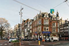 People Walking In Downtown Amsterdam Admiring Beautiful Architecture Of Dutch Houses In Autumn. AMSTERDAM, NETHERLANDS - NOVEMBER 13, 2017: People Walking In Royalty Free Stock Images