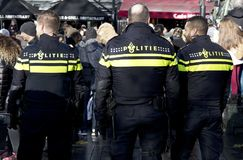 Tree dutch police officers watching people royalty free stock photos