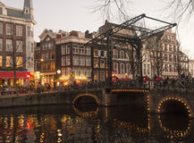 Amsterdam. Netherlands - November 30, 2013: View of the Kloveniersburgwal in the city center of .  has more than 150 waterways, deviding the city into 90 mini Royalty Free Stock Photography