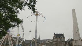 AMSTERDAM, NETHERLANDS - 16 oct 2016, amusement Park - Ferris wheel on Dam Square - historical center of Holland CAPITAL. Wide angle stock video