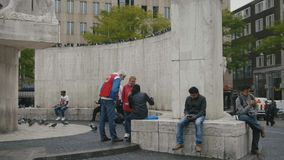 AMSTERDAM, NETHERLANDS - 16 oct 2016, Dam Square - the volunteers of the charity organizations help the homeless. Immigrant, wide angle stock video footage