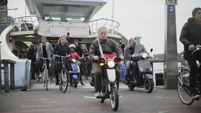 AMSTERDAM, THE NETHERLANDS.18 oct 2016: Ferry to buiksloterweg passengers leave the vessel, slow-motion stock video footage