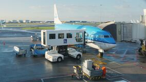 Amsterdam, Netherlands, October 2017: Airliner is preparing for departure. Near the aircraft there is a technical staff. Airliner is preparing for departure stock footage