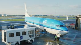 Amsterdam, Netherlands, October 2017: Airliner is preparing for departure. Near the liner is a special catering service. Airliner is preparing for departure stock video