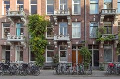Facade of brick house with parked bicycles royalty free stock image