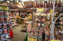Amsterdam. NETHERLANDS - OCTOBER 20, 2013: People on Flower market on October 20, 2013. This is the only floating flower market in the world, and one of the Royalty Free Stock Photos