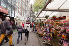 Amsterdam. NETHERLANDS - OCTOBER 20, 2013: People on Flower market on October 20, 2013. This is the only floating flower market in the world, and one of the Royalty Free Stock Photography