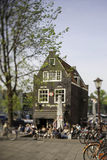 Amsterdam,Netherlands. People having lunch on the terrace on a sunny spring afternoon Stock Photos