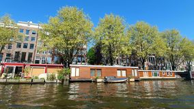 Amsterdam, Netherlands. 25.04.2019. Restaurants located in the canals of Amsterdam. View from the tour boat. Shot with a
