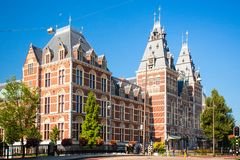 Exterior for of the historic Rijksmuseum with people in view. stock photo
