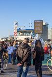 Passengers on IJplein ferry stop in Amstedam, Netherlands stock images