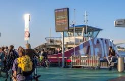 Passengers on IJplein ferry stop in Amstedam, Netherlands stock photos