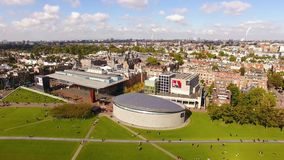 Museum square of Amsterdam, view from above. Amsterdam, Netherlands - September 23 2017: People are visiting the Van Gogh Museum, view from above stock footage