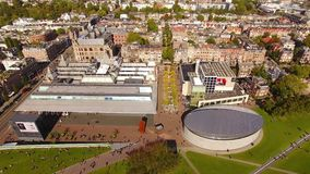 Museum square of Amsterdam, view from above. Amsterdam, Netherlands - September 23 2017: People are visiting the Van Gogh Museum, view from above stock video