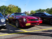 Amsterdam, The Netherlands - September 10, 2016: Second generation Maroon red Chevrolet Camaro Z28 1981. On display during Cars & Coffee XXL show . Non-ticketed Stock Photo