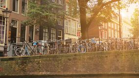 Amsterdam, Netherlands - September 2019: Sunset shot, the flag of the LGBT community hangs on the house. There are many