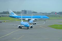 Three planes of KLM airline on the Schiphol Airport airfield Royalty Free Stock Images