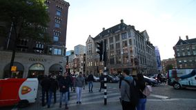 Amsterdam, The Netherlands - September 29, 2018. View of the historical city center. Ancient houses, walking people. Autumn in Ams. Terdam stock footage