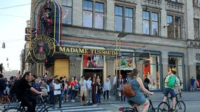 Amsterdam, Netherlands 25.04.2019. Tourists stroll down the street near the Madame Tussauds Museum in Amsterdam, Holland.  stock video footage