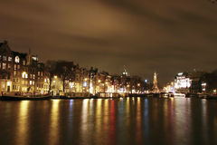 Amsterdam by night. Night scene of amsterdam with light over bay Royalty Free Stock Photos