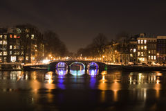 Amsterdam by Night. View on a bridge an canal in Amsterdam by night royalty free stock photo